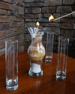 wedding candle lighting ceremny with glass vases surrounding center candle