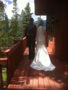 Bride & Groom walking on deck, from behind